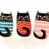 tři kočičí brože